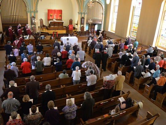 On left, Rev. David Long, incoming pastor and retiring pastor Rev. Bill Long II, of St. John's UCC, enter the sanctuary for Long's final service as pastor of the church on Sunday, October 30, 2016.