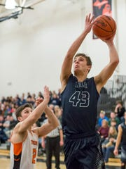 Yale sophomore Sean Koepf takes a shot during a basketball game Friday, Feb. 26, 2016 at Armada High School.
