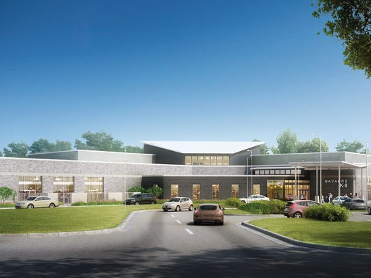 An architect rendering of the front of the kindergarten through eighth grade school set to be built on 42 acres on Elkhart Drive in Navarre. The Santa Rosa County School District unveiled the design earlier this month and will now take the plan to the state in a few weeks for a budget analysis.