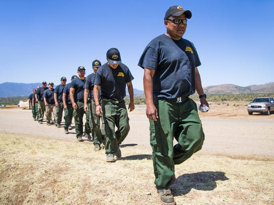 Members of the Fort Apache Hot Shots from White River