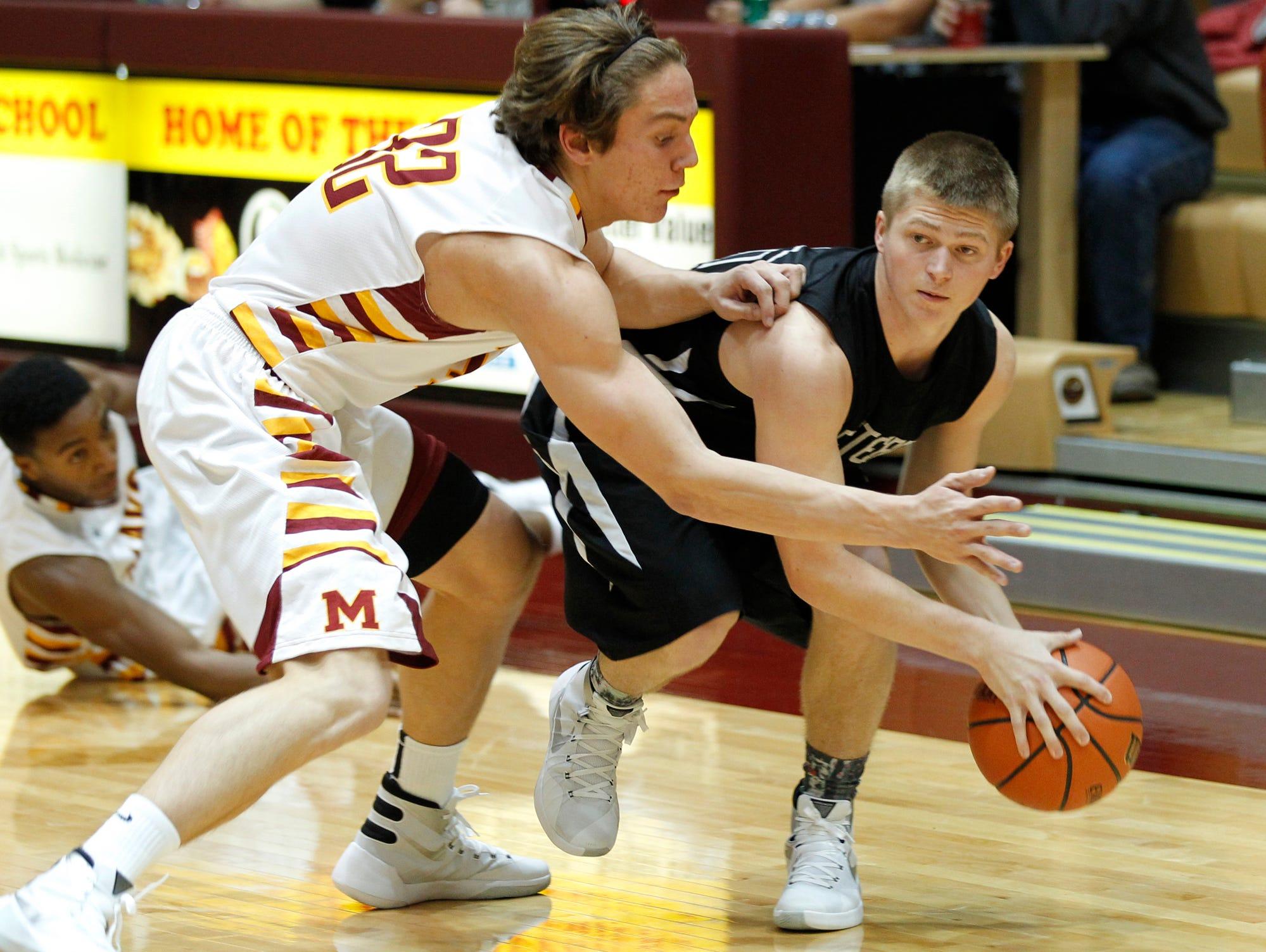 McCutcheon's Haden Deaton tries to steal the ball from Western's Josh Beeler Wednesday, November 25, 2015, at McCutcheon High School. McCutcheon clobbered Western 101-41.