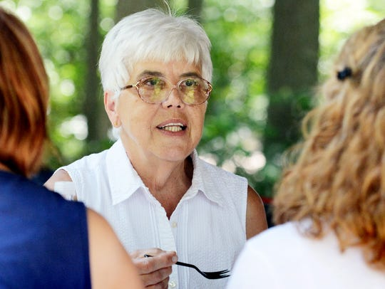 Carolyn Holtzinger chats with friends during a Living