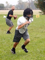 Delphi freshman receiver Riley Lowder runs a pass route