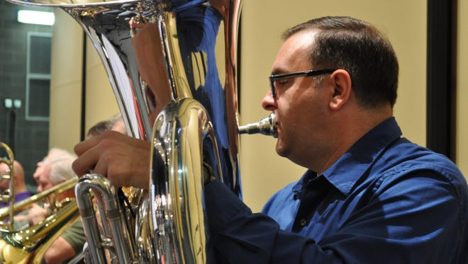 """Robert Nunez rehearses for the Rapides Symphony Orchestra's Saturday concert, """"A Composer's Testimony."""" Nunez is from New Orleans and has been in the Louisiana Philharmonic Orchestra for 23 years."""