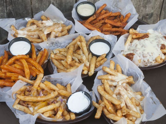 A sampling of the french fries available at The Chicken or the Egg in Beach Haven include (clockwise from top left): disco fries, sweet potato fries, sloppy fries, crabby cheese fries, loaded fries, buffalo fries, and garlic pub fries (center).