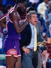 Head Coach John Macleod of the Phoenix Suns looks on
