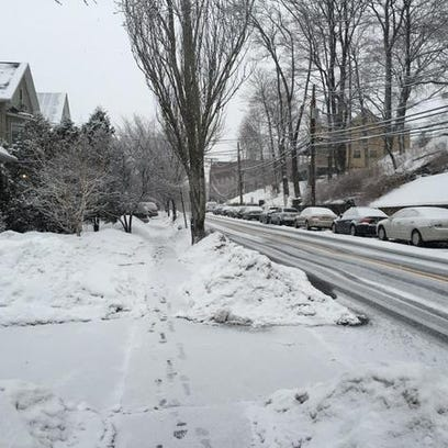 Light snow falls in Morristown  at 7 a.m. Thursday