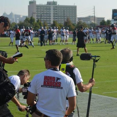 A camera crew from HBO's Hard Knocks series takes in