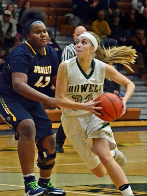 Dannah Jehnke of Howell (right) received high praise from her coach for  coming off the bench and getting heavy minutes in Howell's win over Haslett.