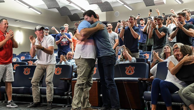 Casey Mize hugs his father, Jason, after being selected No. 1 overall in the MLB draft by the Detroit Tigers on Monday, June 4, 2018, in Auburn, Ala.