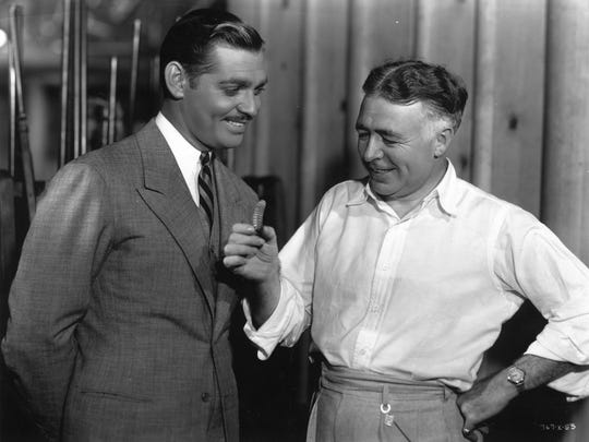 Clark Gable and Clarence Brown with a rattlesnake killed at Brown's Beverly Hills home.