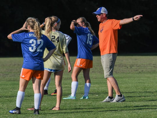 Wren High School standout Kat Syracuse, left, stands near coach Jimmy George, right, and Adrienne O'Brien (15), during practice with the CASA soccer team at Nettles Park in Pendleton on Thursday. The team is preparing for a tournament in Oklahoma.