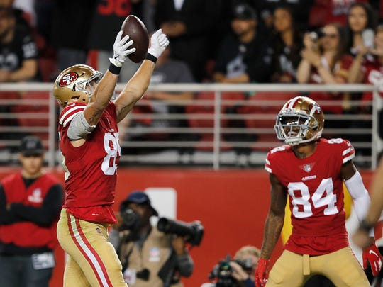 San Francisco 49ers tight end George Kittle, left, celebrates next to wide receiver Kendrick Bourne after a touchdown against the Oakland Raiders during the second half of an NFL football game in Santa Clara, Calif., Thursday, Nov. 1, 2018. (AP Photo/John Hefti)