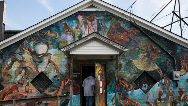 A man makes his way inside Cole's Place on West Kentucky Street for a public meeting with Metro council members Monday evening. June 5, 2017