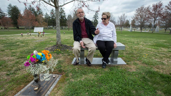 """Rich and Pat Koehler are seen at the gravesite of their granddaughter, Alexis """"Lexie"""" James at Lyndhurst Cemetery, Wednesday, March 28, 2018, in Knoxville, Tennessee."""