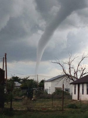 A tornado was confirmed at 4:05 p.m. near the community of Hope, N.M. moving east.