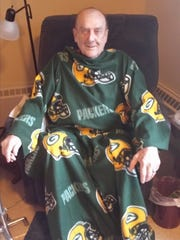 """Gerald """"Jerry"""" Handl dressed up for enjoying the Green Bay Packers play."""