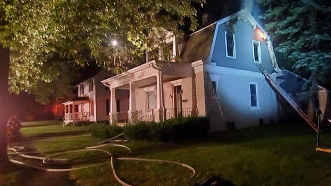 Flames were coming from under the second story eaves when Quincy firefighters after arrived at 20 Wood Ave. late Sunday night.