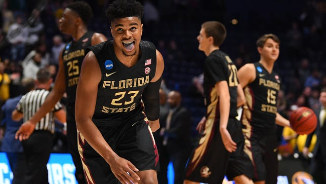 Mar 16, 2018; Nashville, TN, USA; Florida State Seminoles guard M.J. Walker (23) reacts after defeating the Missouri Tigers in the first round of the 2018 NCAA Tournament at Bridgestone Arena. Mandatory Credit: Christopher Hanewinckel-USA TODAY Sports