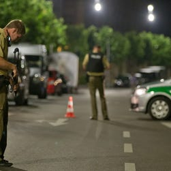 A policeman with a machine gun stands guards in Ansbach, Germany, 25 July 2016.