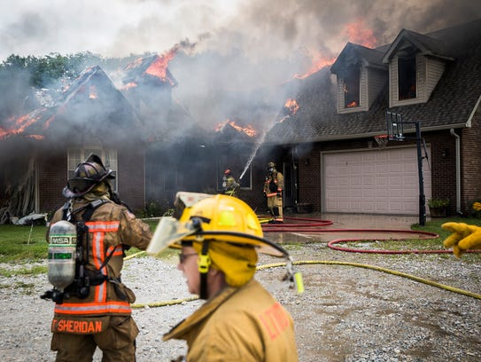 Firefighters respond at the scene of a fully involved