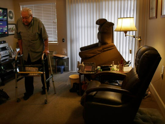 Jean Shaw, 95, stays active at Atria Hillcrest  in Thousand Oaks by handing out chocolates to the other residents. It is his way of coping with the recent death of his wife of 73 years.