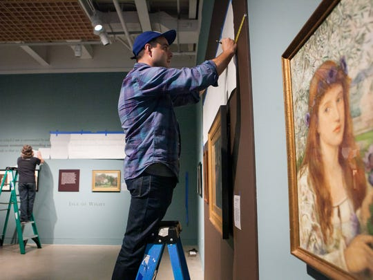 Preparator John Gibbons (left) and Just Webb work on the new exhibit, Poetry in Beauty: The Pre-Raphaelite Art of Marie Spartali Stillman, at Delaware Art Museum that will run from November 7 - January 31, 2016.
