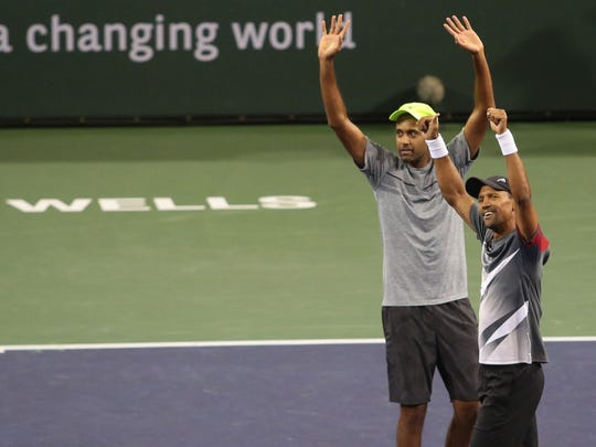 American Rajeev Ram, left, and South African Raven Klaasen wave to the crowd after beating Marcelo Melo, of Brazil, and Lukasz Kubot, of Poland, in the BNP Paribas Open men's doubles finals on Saturday, March 18, 2017.