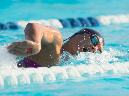 Barron Collier's Isabella Marsala swims in the 200-yard freestyle preliminaries  at the FHSAA Class 3A Swimming and Diving Finals at Sailfish Splash Waterpark in Stuart on Friday, Nov. 4, 2016.
