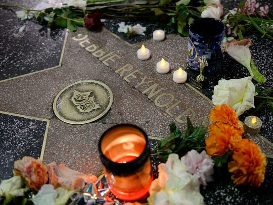 Flowers were placed on Debbie Reynolds's live performance