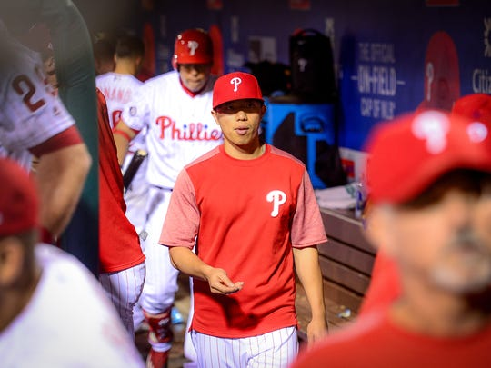 Derrick Chung, the Korean interpreter for Phillies outfielder Hyun Soo Kim, in the dugout during Saturday's game against the Mets at Citizens Bank Park.