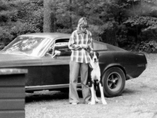 Robbie Kiernan with the family dog Gatsby alongside her in 1977 with the original Mustang from the 1968 movie Bullitt.