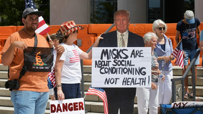 """A cutout of President Donald Trump made an appearance at a """"Freedom Rally"""" opposed to Jacksonville's mandate to wear masks July 6."""