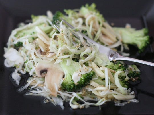 Sesame Slaw with Mushrooms, Broccoli and Almonds gives way for a healthier slaw.