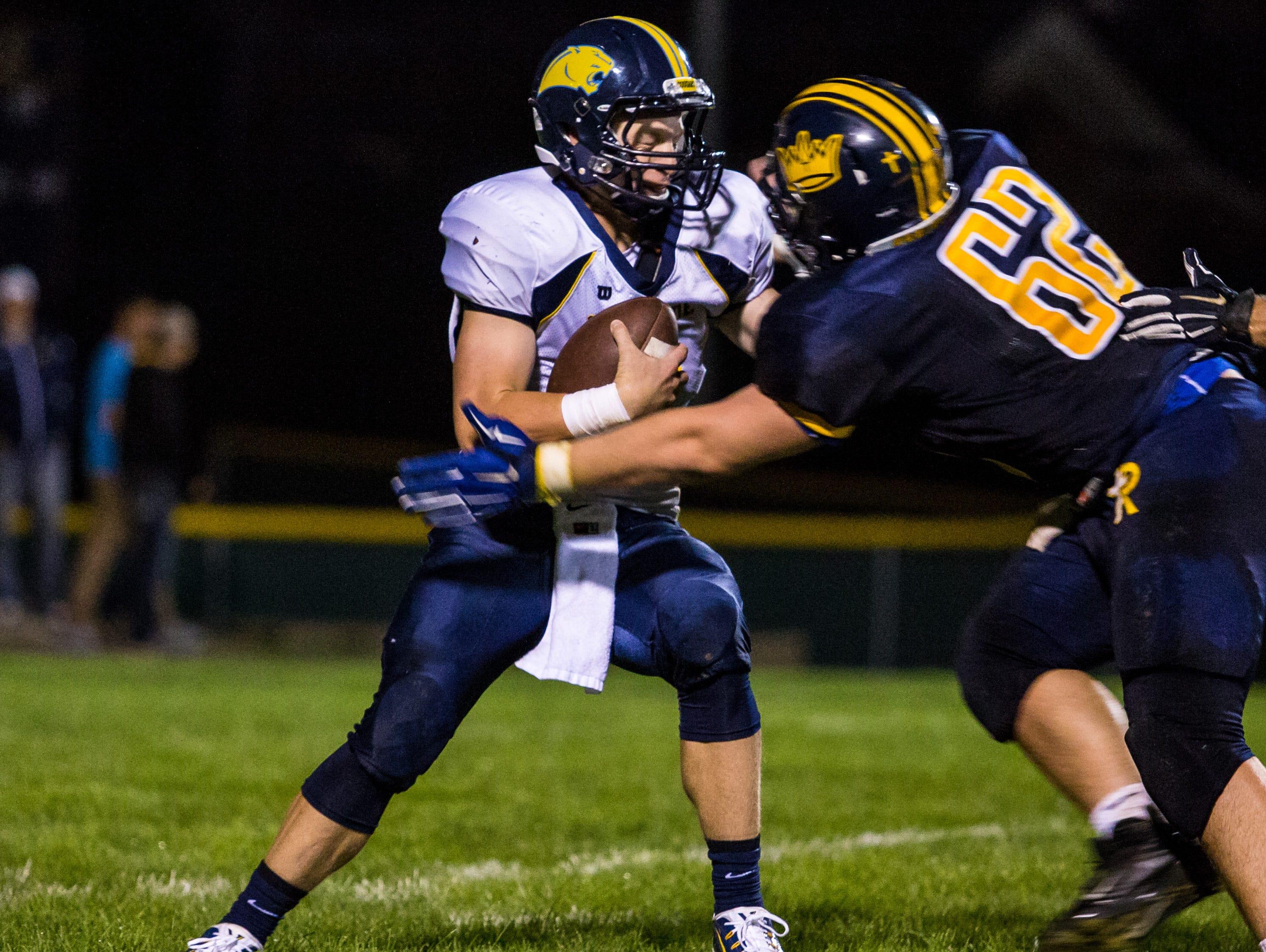 Iowa City Regina's Jared Brinkman makes a tackle against Cascade last year.
