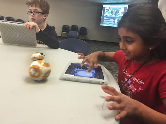 Riddhi Piyush, 7, (right) makes robot Sphero rotate while making circles on the iPad screen while Liam Alexander, 9, learns coding during Camp STEM at Volunteer State Community College in Gallatin on Tuesday, March 29, 2016.