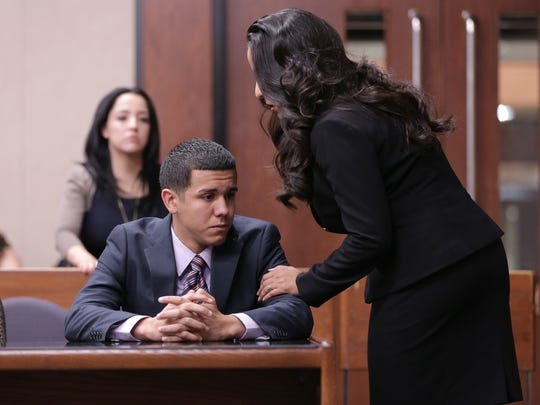 Jan Michael Nieves Delgado is comforted by one of his attorneys after hearing a guilty verdict from the clerk after it was originally read not guilty Thursday in the 168th District Court. Delgado is a former Fort Bliss soldier accused of killing two highway workers in 2014 after running through the construction barricade on I-10.