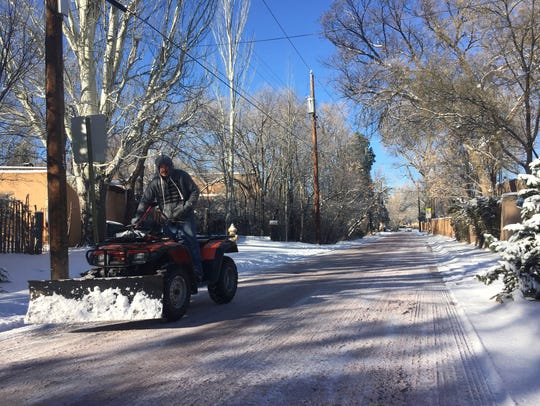 Residents of Santa Fe, N.M., dig out from a winter