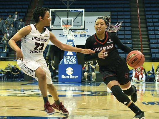 UL's Troi Swain (10) drives the ball toward the basket. Swain scored seven points Saturday in the Ragin' Cajuns Sun Belt Tournament upset of No. 1-seeded Little Rock.