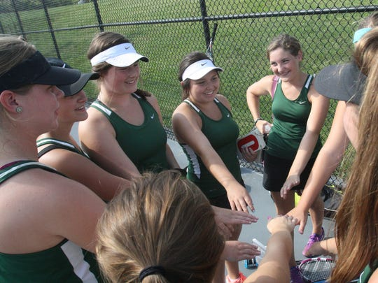 Seton High School's tennis team comes together before a match with Mercy last September. They return Alex Fieler and Mackenzie Vatter.