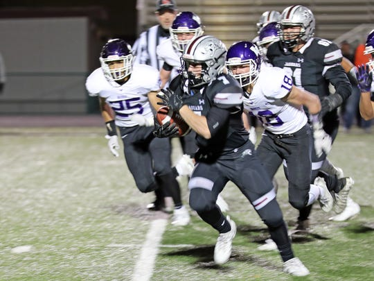 Ankeny Centennial senior running back Hunter Wright (7) heads for a first down as the Waukee Warriors compete against the Ankeny Centennial Jaguars during the opening half of the first round 4A playoff game at Ankeny Stadium. The winning team advances to the quarterfinal match on Friday, Oct. 27, 2017.