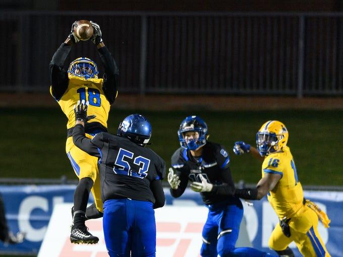 Northwestern's Damarco Harris (#18) intercepts the