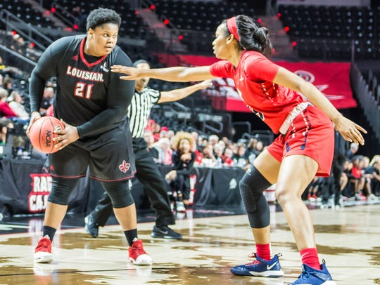 UL forward Nekia Jones (21) looks to pass the ball