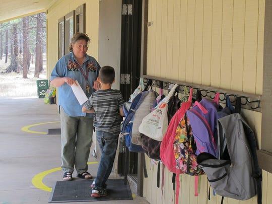 Second-grade teacher Susan Crouse talks to a student