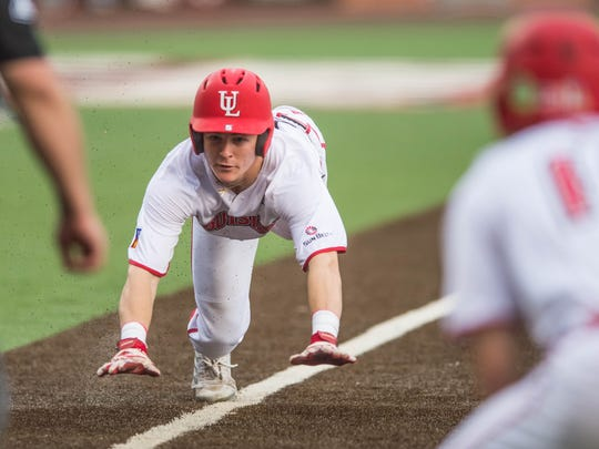 UL's Hayden Cantrelle dives into home with UL's first run in a 12-6 win over No. 15 Coastal Carolina on Friday night at The Tigue.