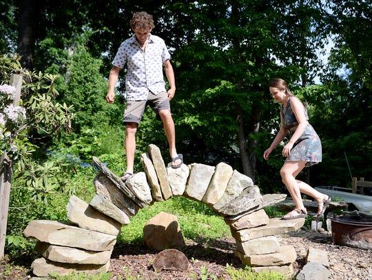 Peter Pfister and Samantha Bowers climb a stone arch