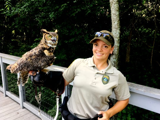Radnor Park ranger Teshia Steuben talks about the great horned owl that is a favorite with the park's aviary visitors.