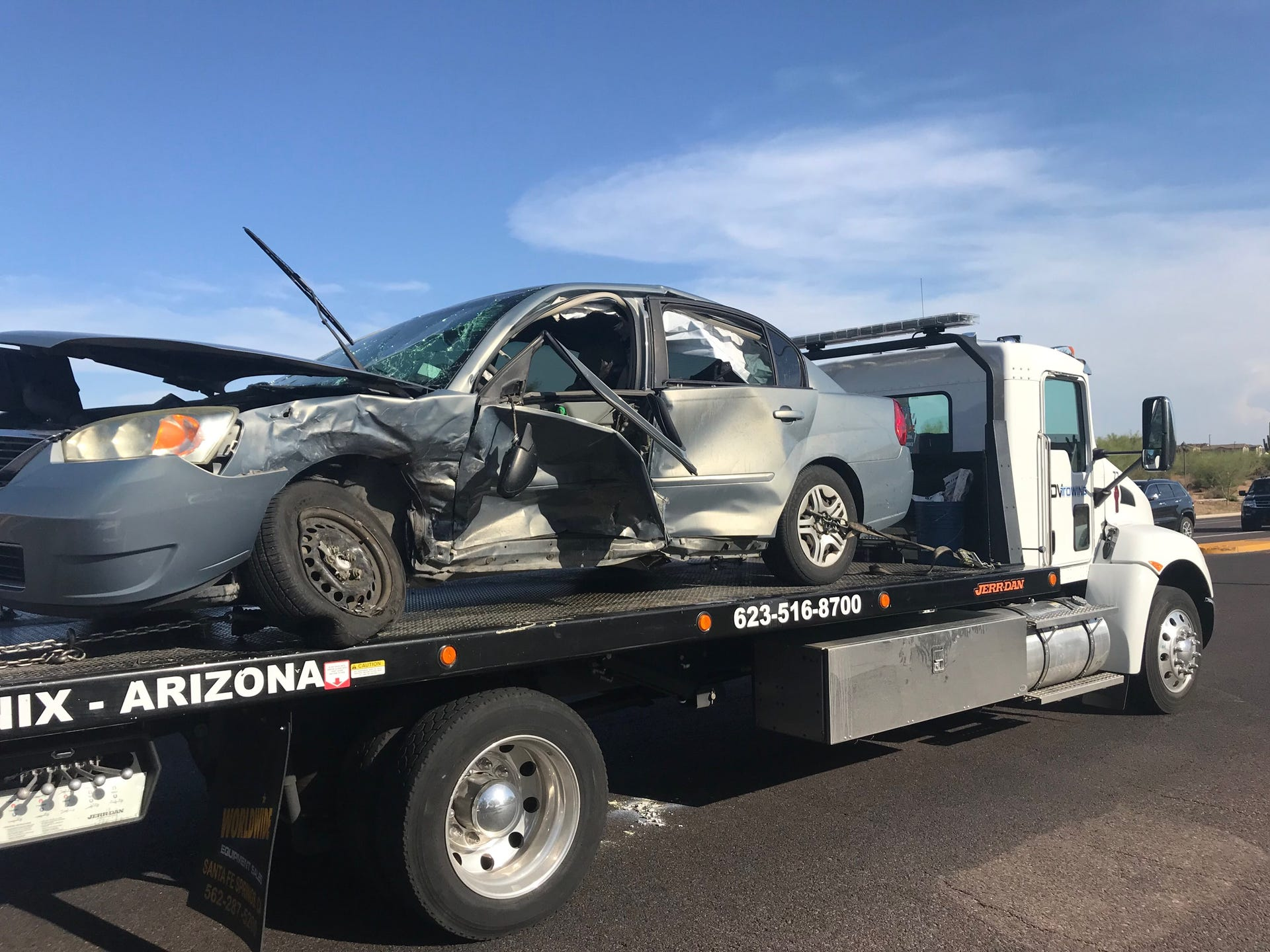 Phoenix police officer injured in car crash