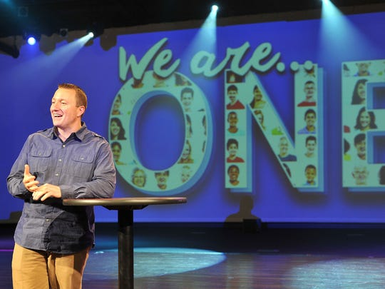 Dave Vance talks about a couple of his favorite Bible passages at Crossroads Community Church Wednesday afternoon. Vance, 37, was hired as Crossroads' second ever pastor.