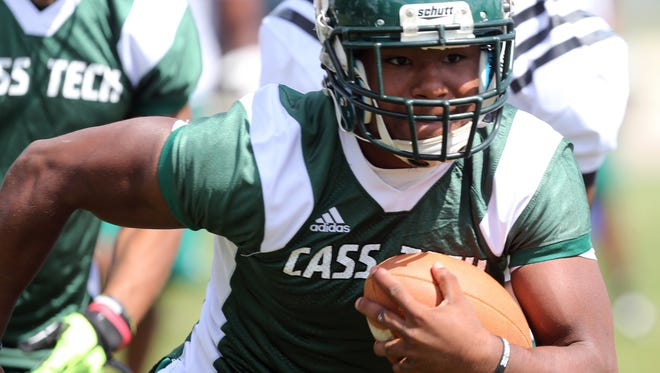 Cass Tech's Mike Weber goes through drills during a practice in 2013.